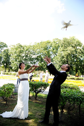 Bride and groom with pigeons at the wedding walk